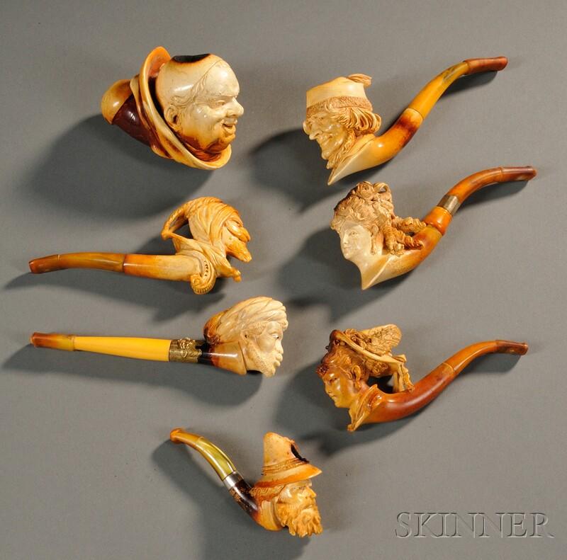 Seven Carved Meerschaum Portrait Pipes