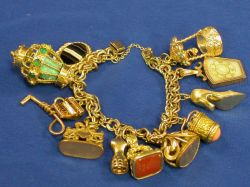12kt Gold-filled Charm Bracelet with a Variety of Antique Fobs and Charms.