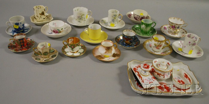 Sixteen Assorted European Decorated Porcelain Cups and Saucers with a Four-piece Meissen Chinese Dragon Decorated Porcelain Desk Set...
