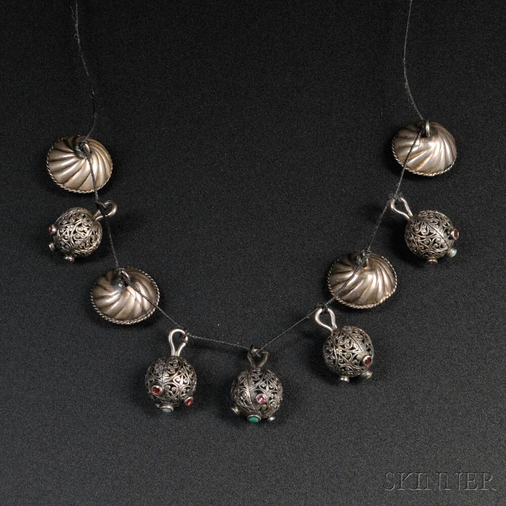 Nine Persian Silver Charms