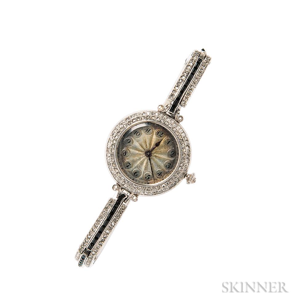 Lady's Platinum, Onyx, and Diamond Wristwatch, Dreicer & Co.