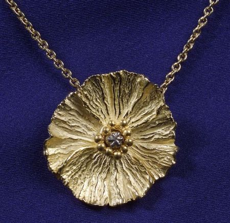 22kt and 18kt Gold and Platinum Pendant Necklace, Bass