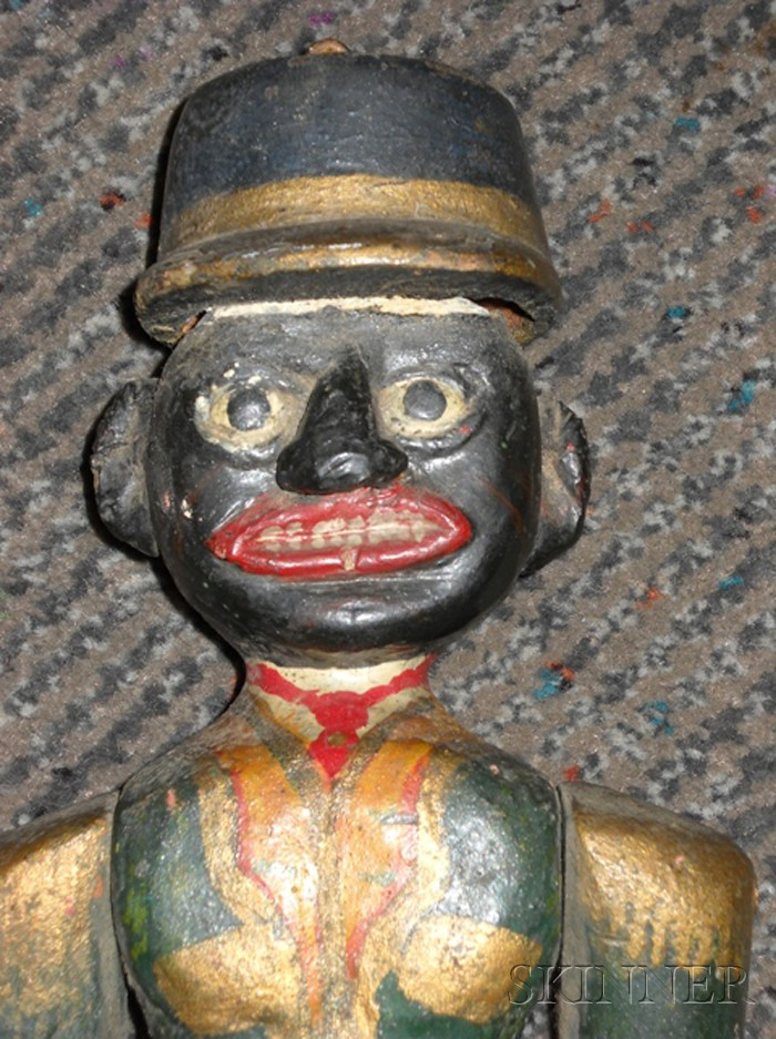 Carved and Polychrome-painted Articulated Figure of a Black Man