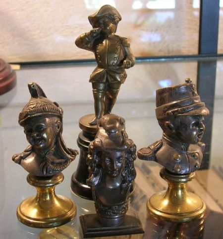 Four Small Bronze Figurals and Silvered Metal Figurals.