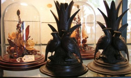 Pair of Victorian-style Dried Flower Studies under Glass Domes, and a Pair of Black Forest Carved Wood Figural Vases