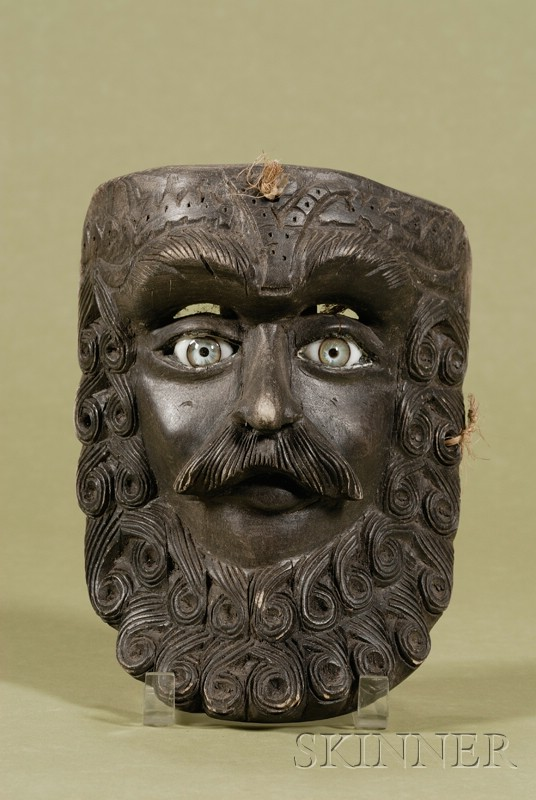 Carved and Ebonized Wood Mask with Glass Eyes