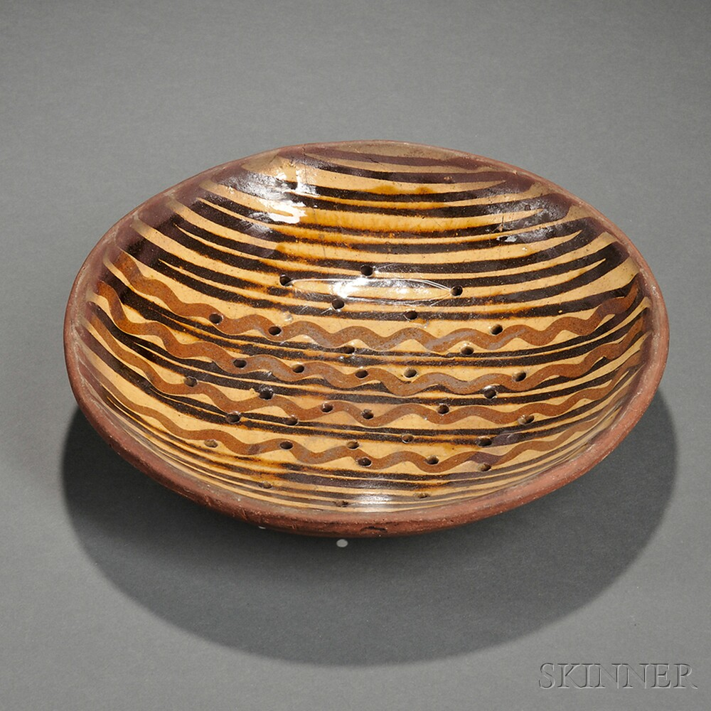 Slip-decorated Redware Strainer