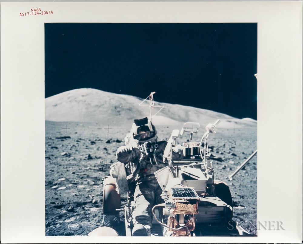 Apollo 17, Harrison Schmitt Mounting the Lunar Roving Vehicle, December 1972.