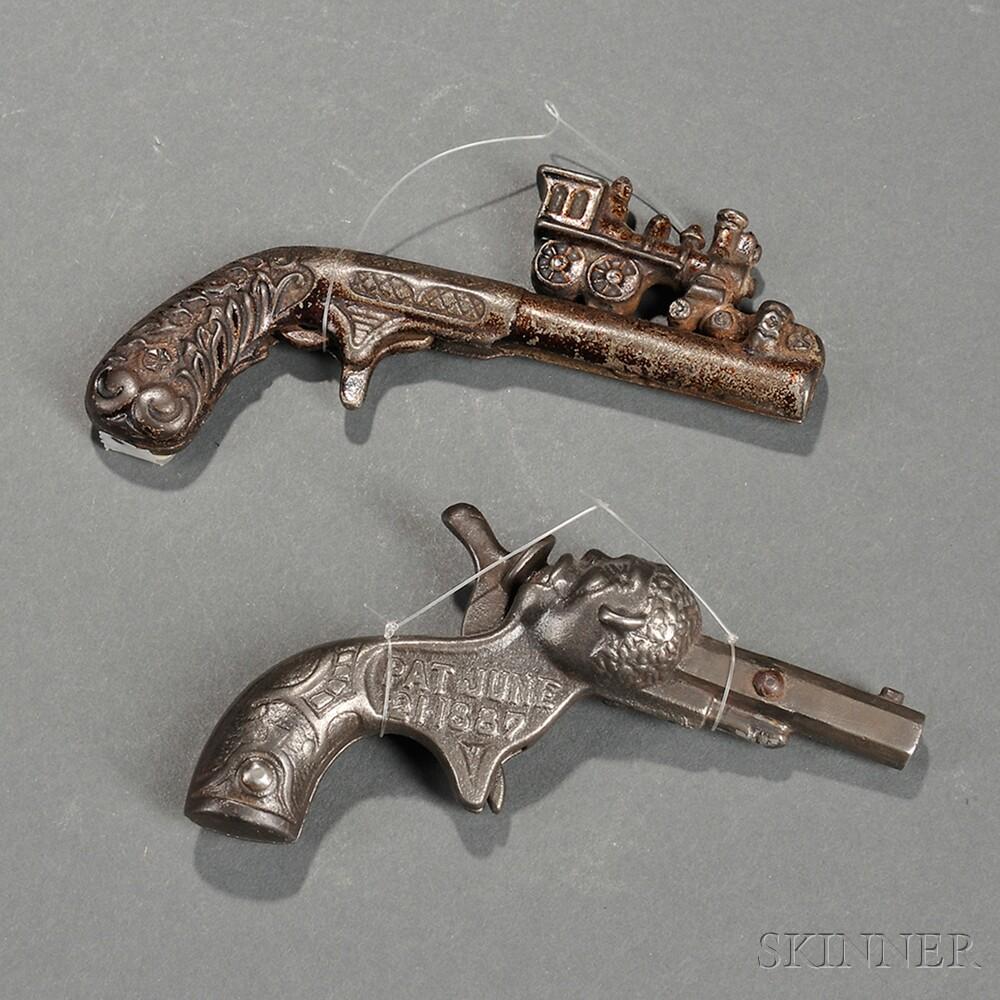 Two Cast Iron Toy Cap Guns,