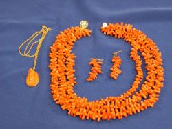 Coral Necklace, Earrings, and a Carved Coral Cameo Pendant.