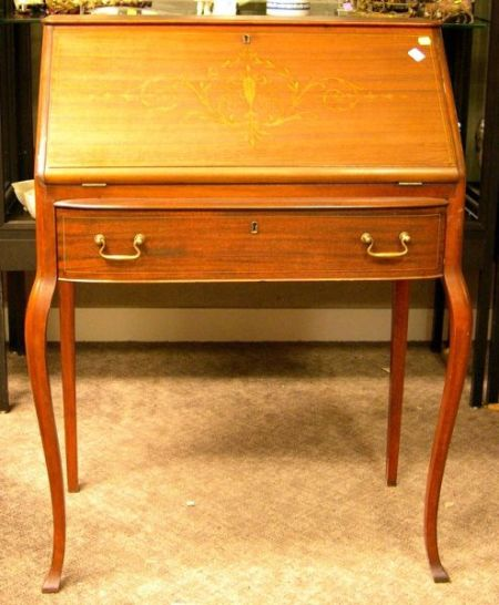 edwardian writing desk Driscolls antiques ltd has clarified that the walnut writing desk (05917 / la41207) is antique and it's date/period of manufacture is edwardian.