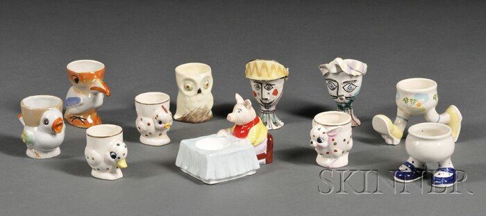 Collection of Thirty-four Ceramic and Glass Egg Cups