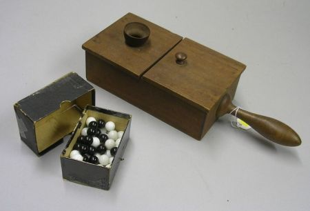 Mahogany Voting Box with Handle and Fifty-four White and Black Glass Voting Marbles.