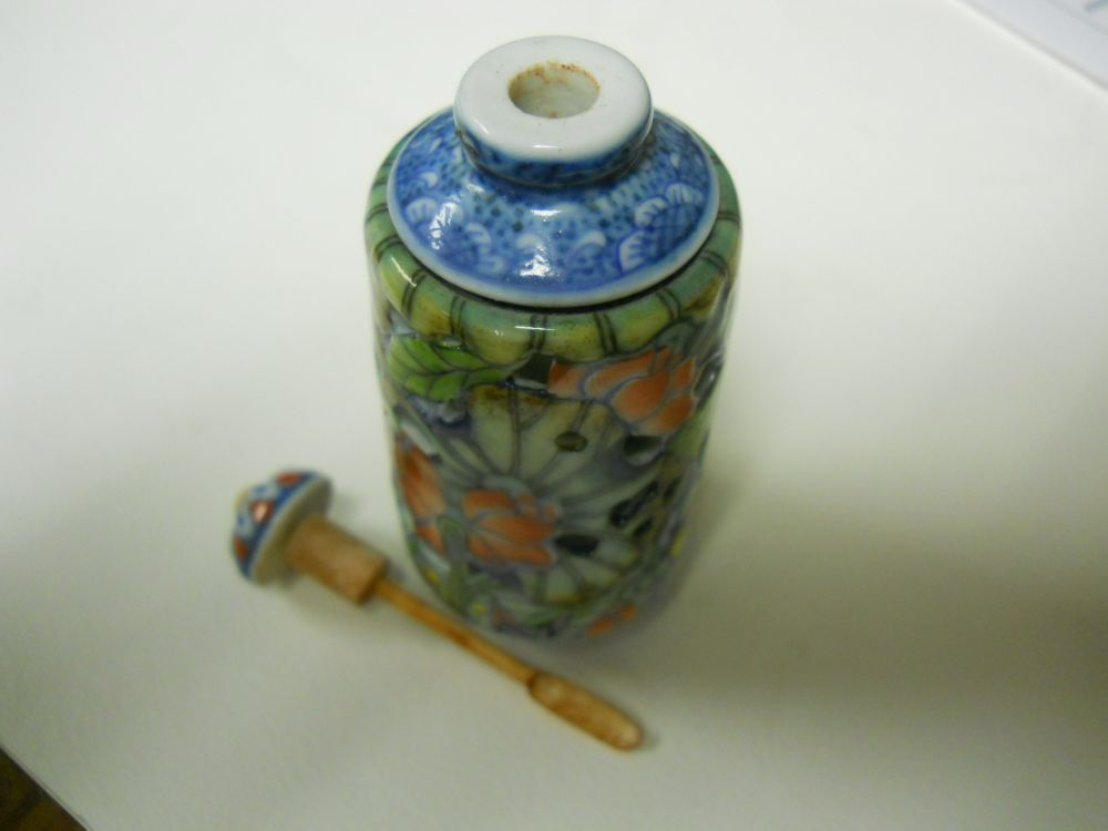 Two Rotating Openwork Ceramic Snuff Bottles
