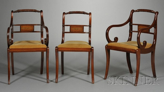 Set of Eight Regency Brass-inlaid and Carved Mahogany Dining Chairs