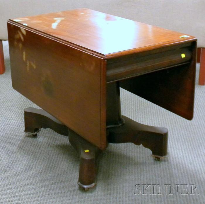 Empire-style Mahogany Deep Drop-leaf Pedestal-base Dining Table.