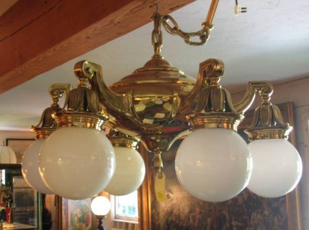 Brass Six-Light Chandelier with Opaque Glass Globes.