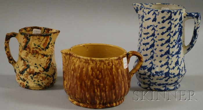 Two Spongeware Pitchers and a Rockingham Glazed Yellowware Batter Pitcher