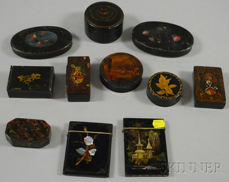 Eleven Small Gilt and Polychrome-decorated Black Lacquered and Painted Boxes and   Cases