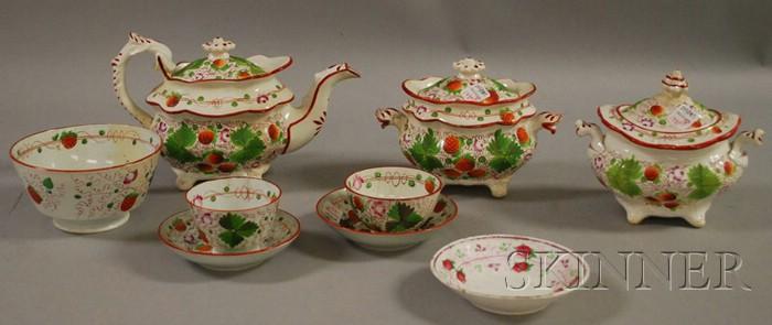 Eight-piece English Strawberry Pattern Staffordshire Partial Tea Set.     Estimate $100-150