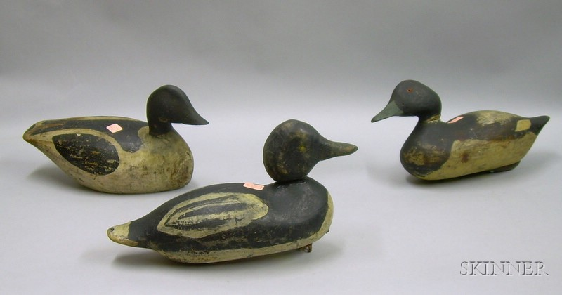 Three Carved and Painted Wooden Duck Decoys.