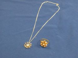 14kt Gold and Diamond Ring and a 14kt Gold and Diamond Pendant.