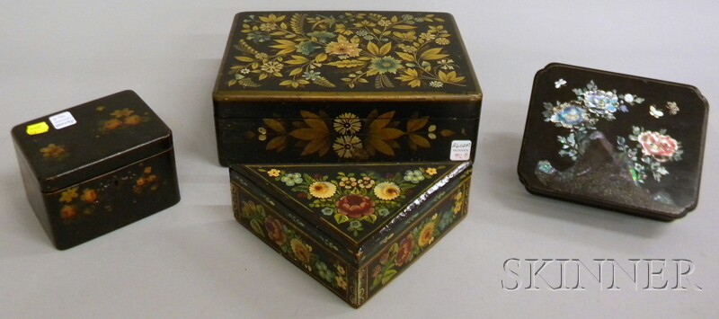 Four Assorted Polychrome-decorated Black-painted Wooden Boxes.