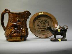Rockingham Glaze Pitcher, Bennington Cow Creamer and a Continental Carved Wood Plaque.