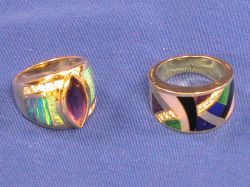 Two Contemporary 14kt Gold and Gem-set Rings.