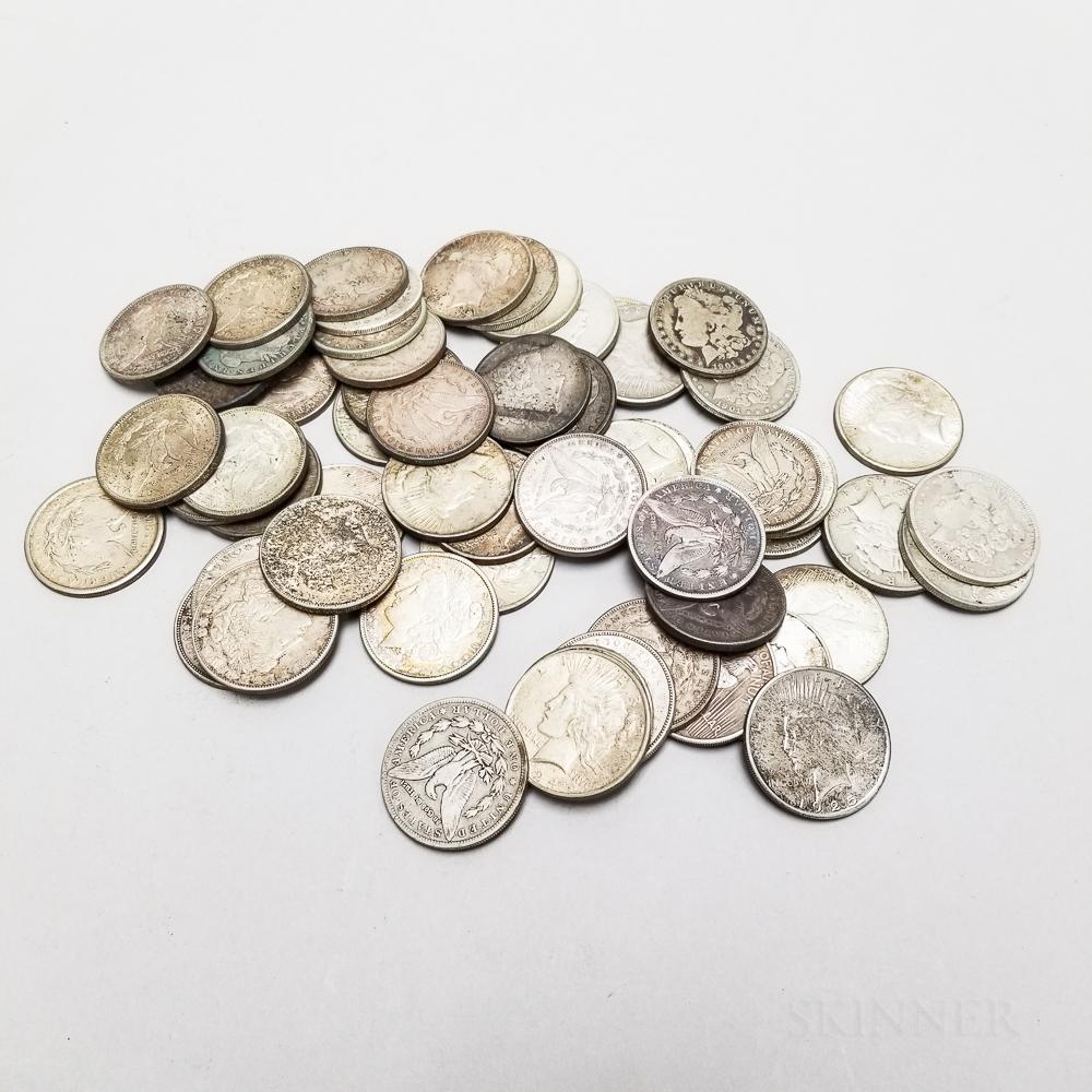 Fifty-nine Morgan and Peace Dollars