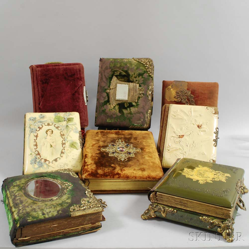 Fifteen Mostly Brass-mounted Victorian and Art Nouveau Photo Albums.     Estimate $200-300