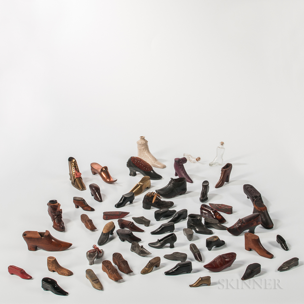 Collection of Approximately Fifty-two Shoe-form Snuffboxes and Pincushions