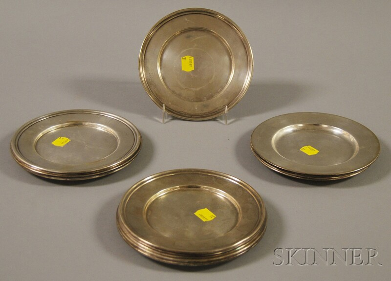 Sixteen Sterling Silver Bread Plates