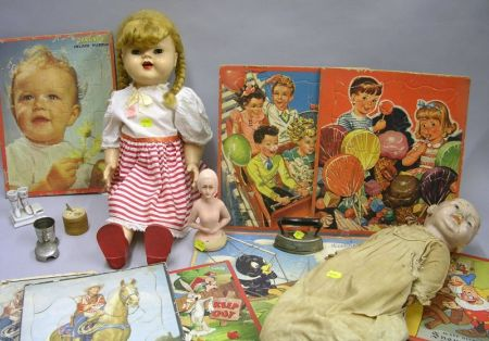 Seven Mid-20th Century Childrens Chromolithograph Puzzles, Two Dolls and Miscellaneous Toys and Articles.