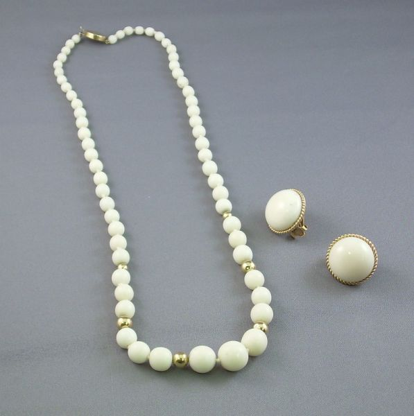 14kt Gold and White Coral Beaded Necklace and a Pair of 14kt Gold and White Coral Button Earclips.