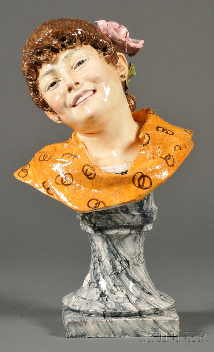Continental Faience Bust of a Smiling Maiden