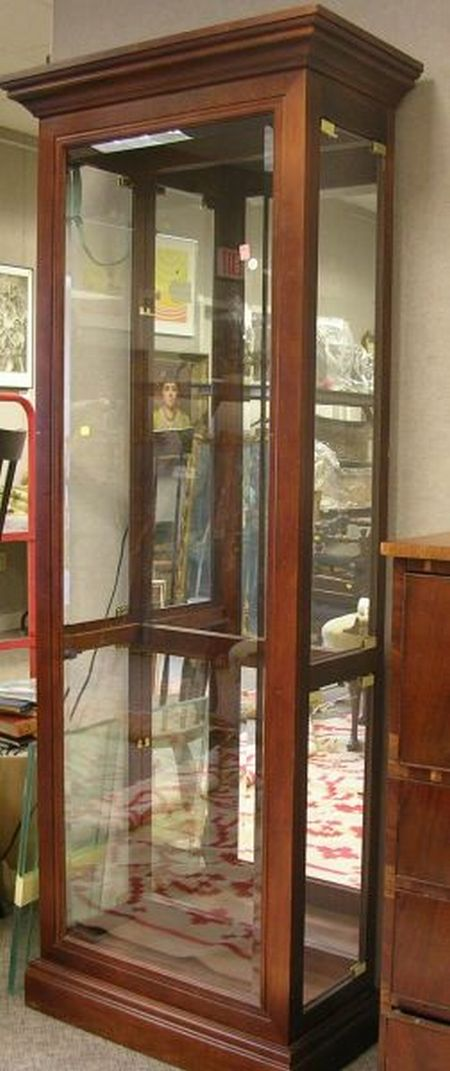 Modern Glazed Cherry-Finished Display Cabinet with Beveled Glass.