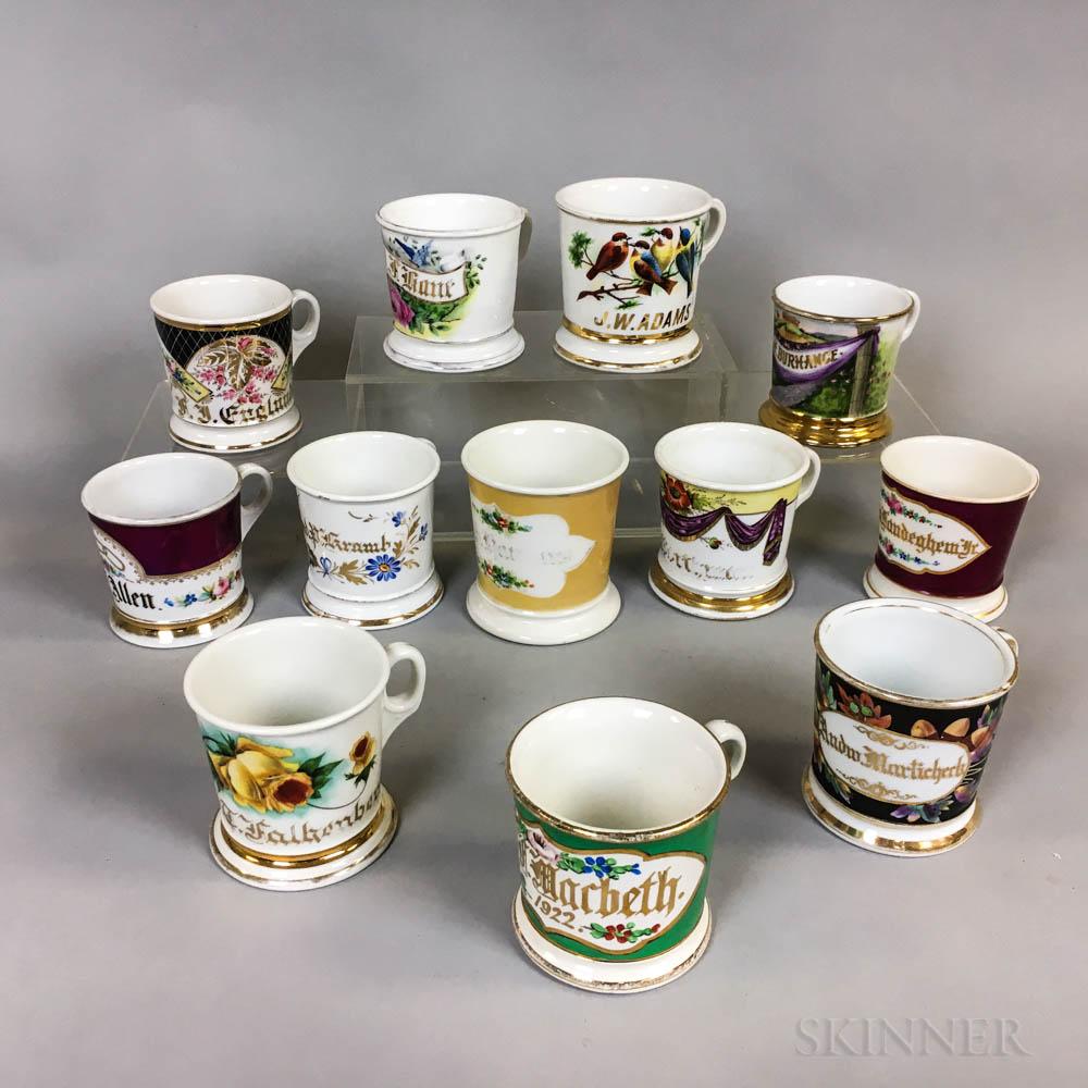 Twelve Floral-decorated Porcelain Shaving Mugs.     Estimate $200-400