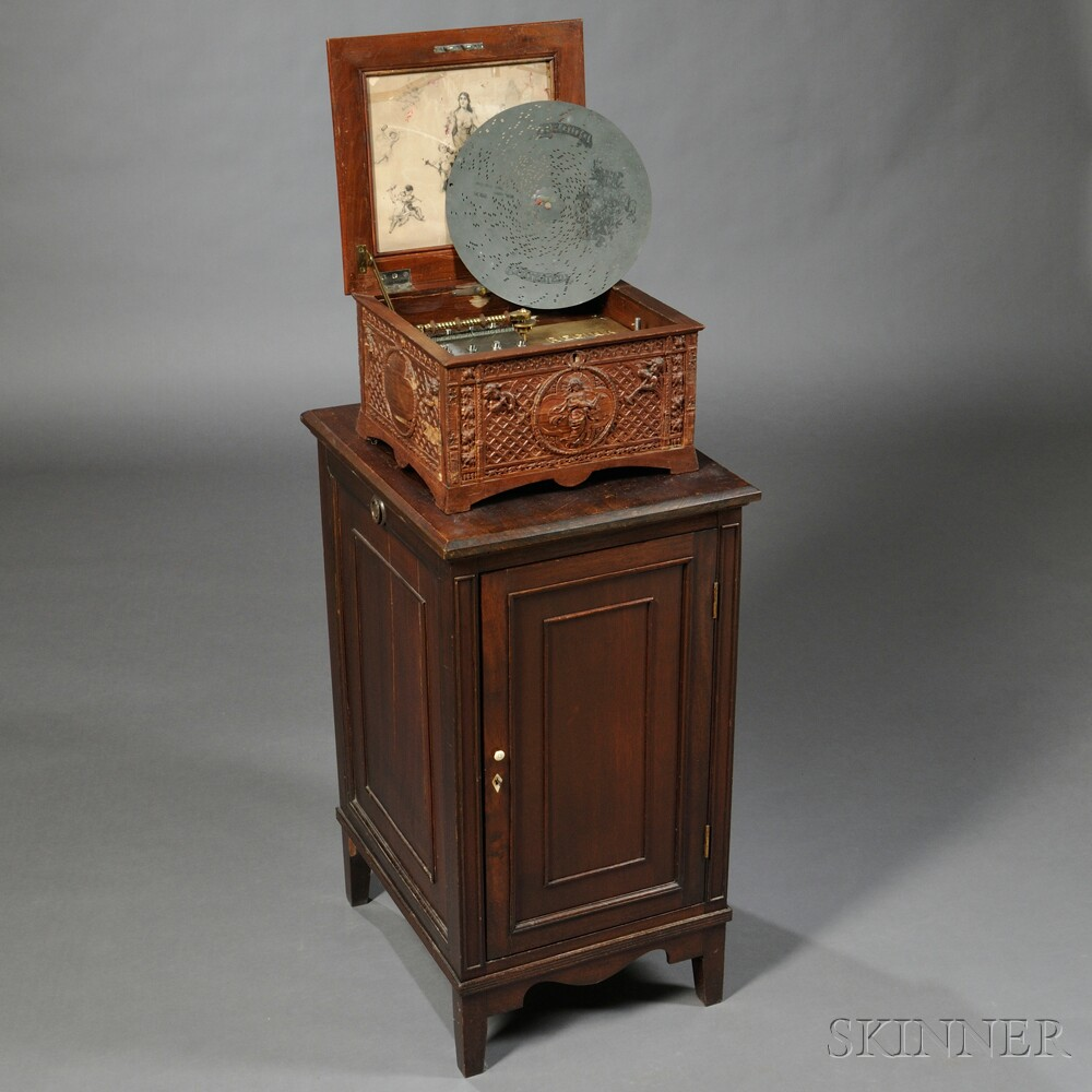 Carved Regina 11-inch Disc Musical Box and Cabinet