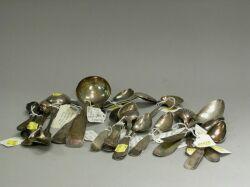 Twenty-eight Coin Silver Spoons.