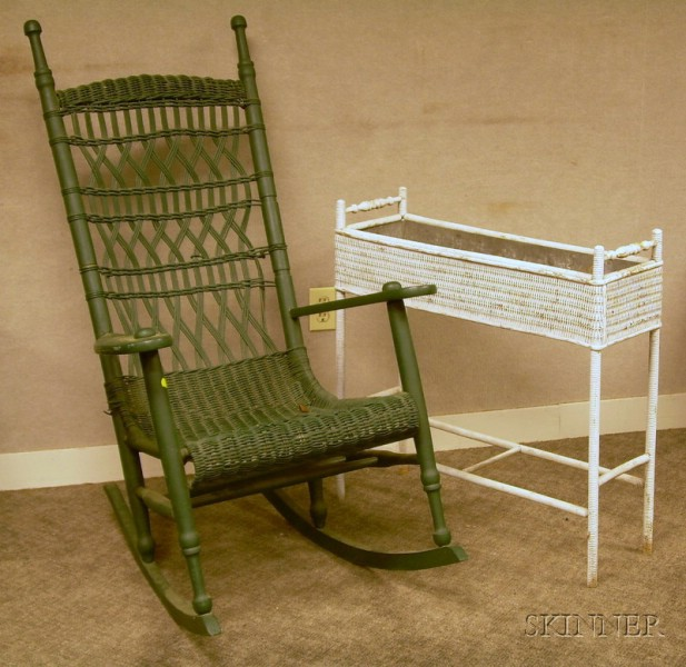 Green-painted Wicker-woven Wooden Porch Armrocker and a White-painted Woven Wicker Planter.