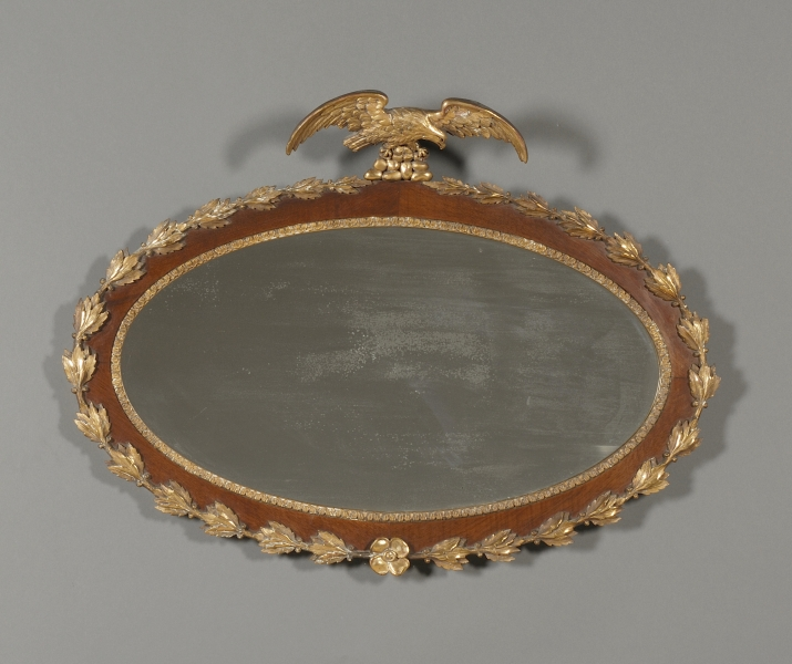 Regency Style Mahogany and Parcel-gilt Oval Mirror
