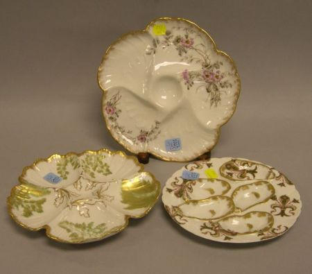 Three Limoges Gilt and Transfer Decorated Porcelain Oyster Plates.
