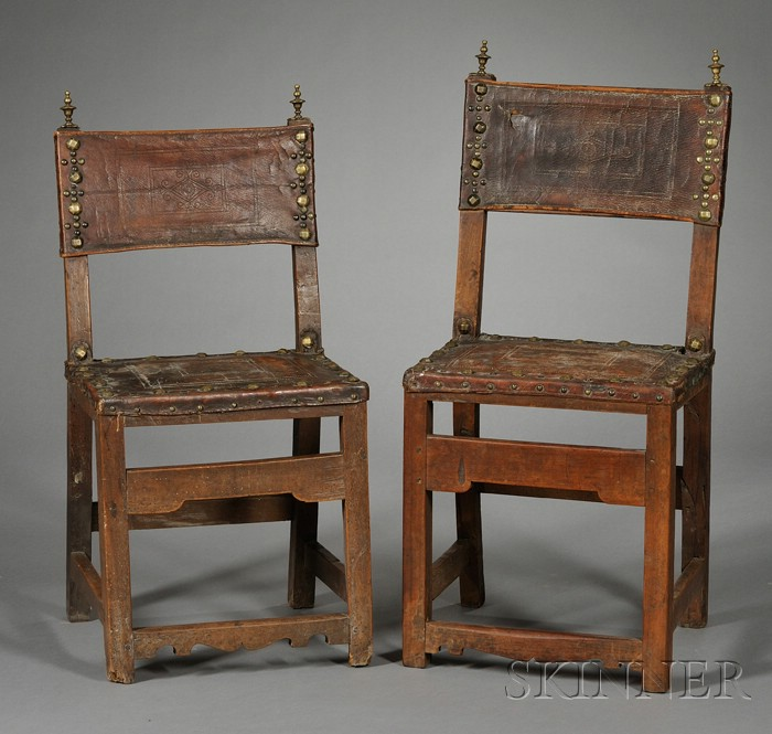 Two Spanish Baroque Walnut, Tooled Leather and Brass-mounted Side Chairs
