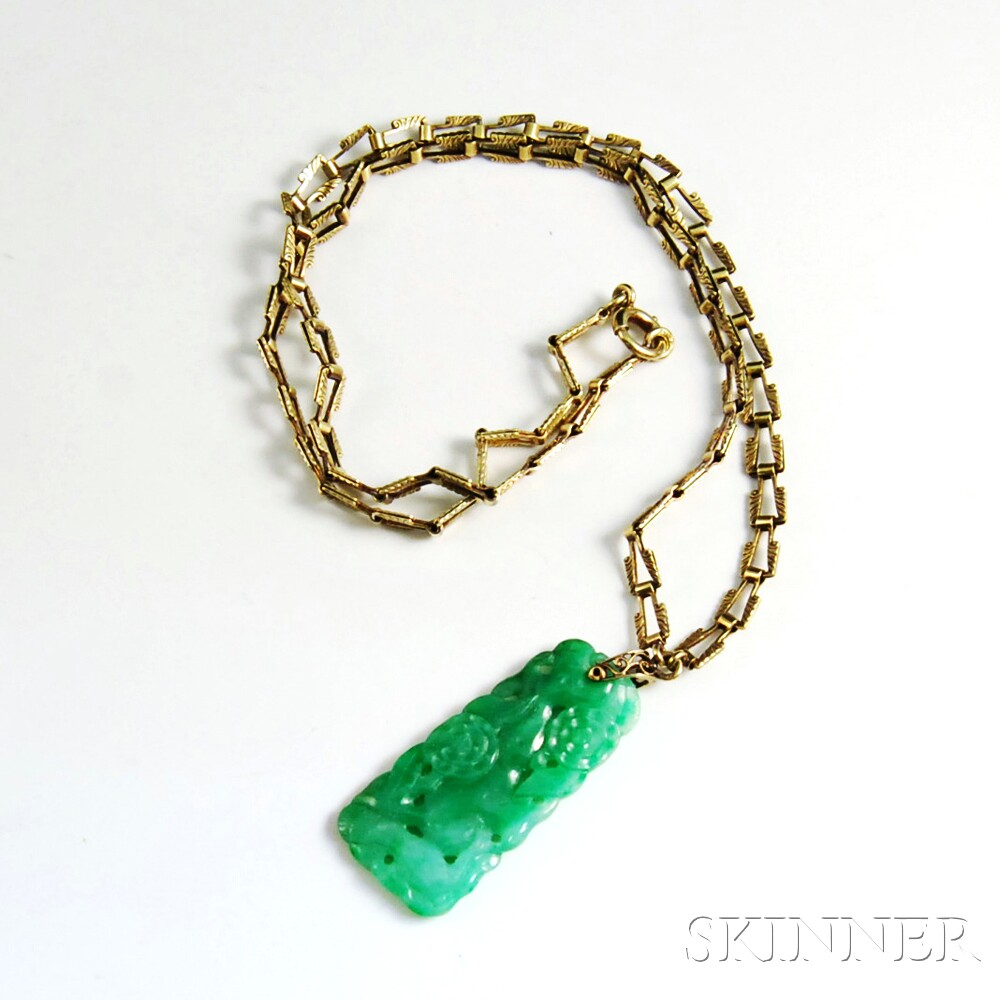 Carved jade pendant on a 14kt gold chain sale number 2872t lot carved jade pendant on a 14kt gold chain aloadofball Gallery