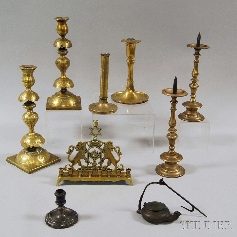 Nine Mostly Brass Lighting Devices