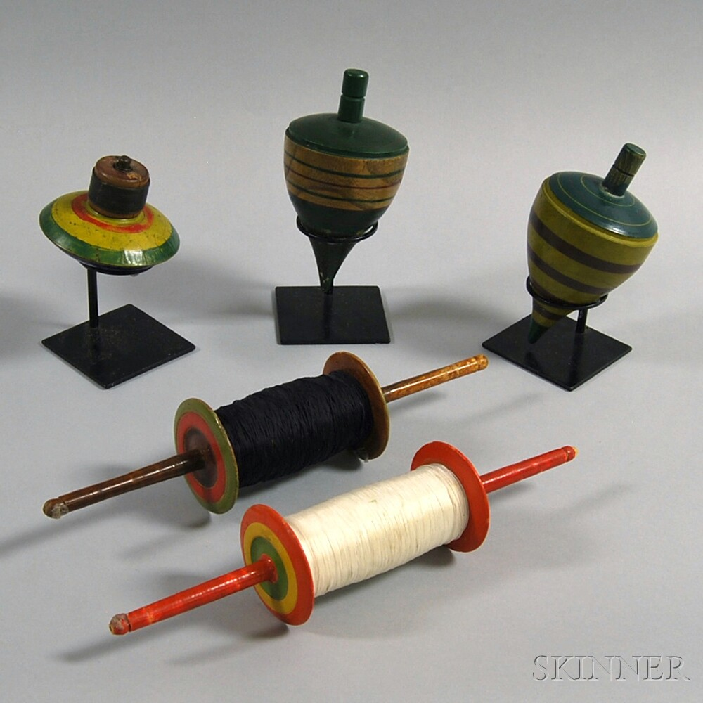 Three Large Painted Tops and Two Kite Spools
