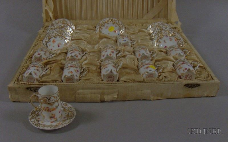 Cased Partial Set of German Gilt and Floral Transfer Decorated Porcelain Demitasse   Cups and Saucers