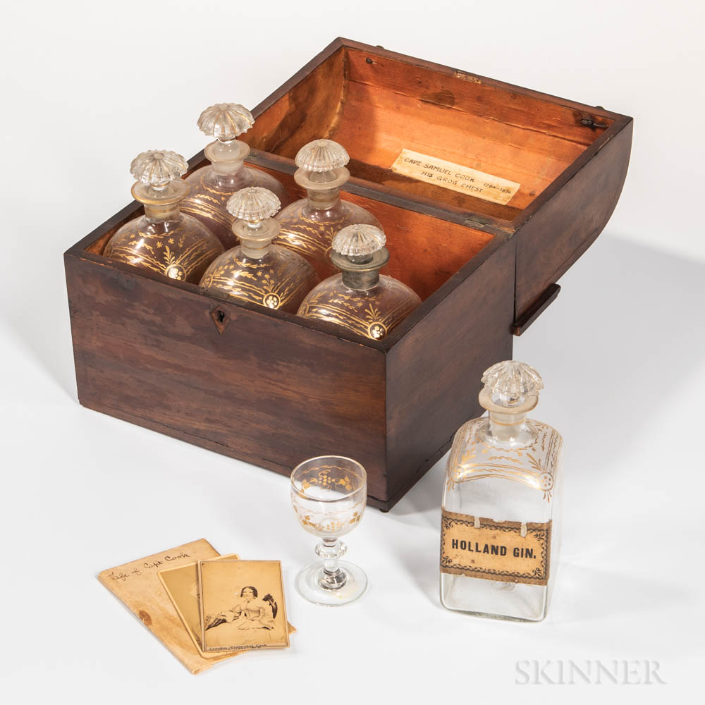 The Captain Samuel Cook Mahogany Veneer Liquor Chest and Six Gilt-decorated Blown Glass Bottles