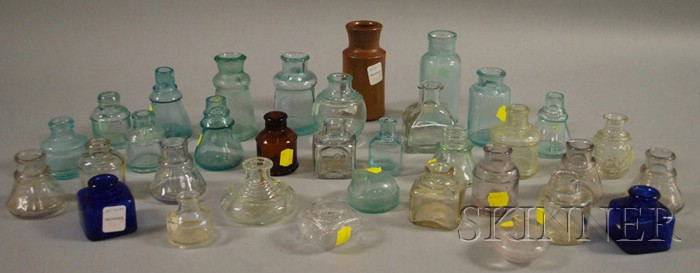 Thirty-four Mostly Aqua and Colorless Glass Inkwells and Bottles
